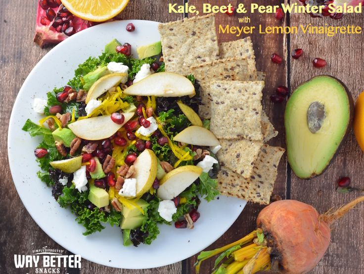 Kale, Beet & Pear Winter Salad from @WayBetterSnacks. Crisp kale, golden beets, juicy pomegranate and sweet pears are tossed with Meyer lemon vinaigrette for a winter salad that'll set your taste buds dancing. #glutenfree #vegetarian #WayBetterRecipe