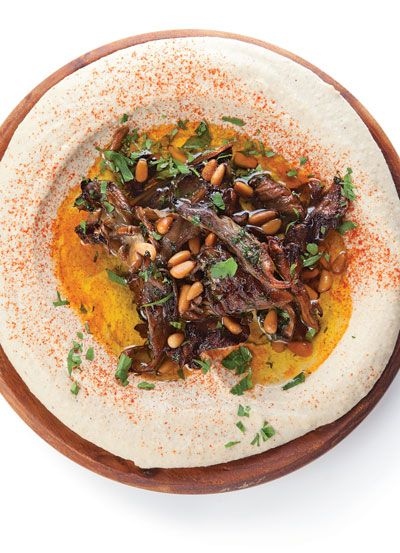 A silky, cumin-laced chickpea spread, that gets contrasting texture and a savory boost from a tangle of mushrooms.