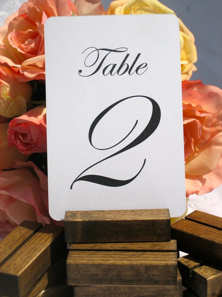 Rustic wood table number holders. Size: 3 inches long Finish: Dark Walnut Rustic wooden table card holders. Perfect for your rustic chic wedding, dinner party, bridal showers, or any rustic themed eve