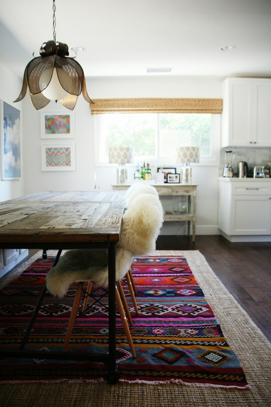 Boho kitchen - gorgeous recycled timber, sheepskin & bright ethnic rug.