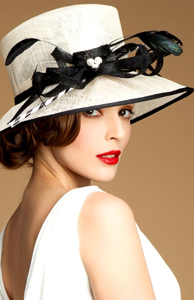Woman Royal Hats.  when a women wears a hat which matches her fashions style dressing she shows an extra character profile of her measure self = quality and what she has in mind to her class standings as a future partner ---business or personal...Roger M. Christian PS the same is true for a man!