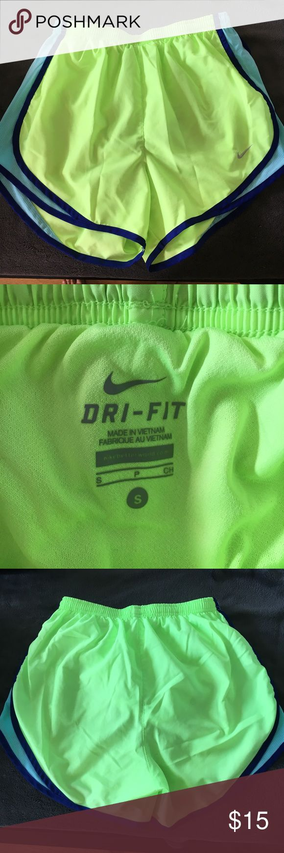 Neon green Nike dry fit shorts Barely worn! Neon green shorts with light blue and navy lining on the side. Lining on the inside and drawstring. Nike Shorts