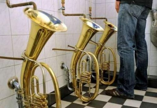 Music Lover or Brass Band Hater?    Because this is pure creative genius, this is one of our favorite sets of urinals on the list. Although, truth be told, we can't decide of it's a music lover or a saxophone hater that dreamt up these fine bathroom fixtures.