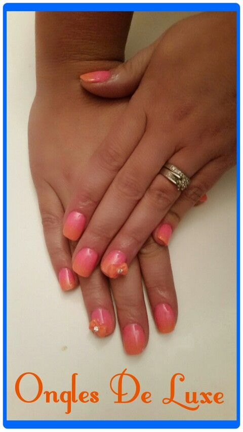 Pink and orange ombre nails with orange bows