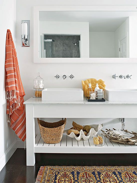 White walls, a white vanity, and white accessories make this master bathroom  feel sleek and sophisticated. A marble slab countertop pairs well with  simple ...