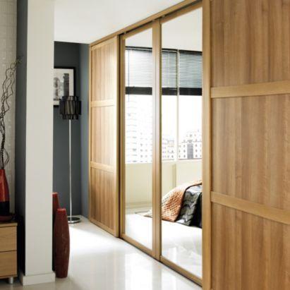 B Amp Q Mirrored Sliding Wall To Wall Wardrobe Door Oak Effect