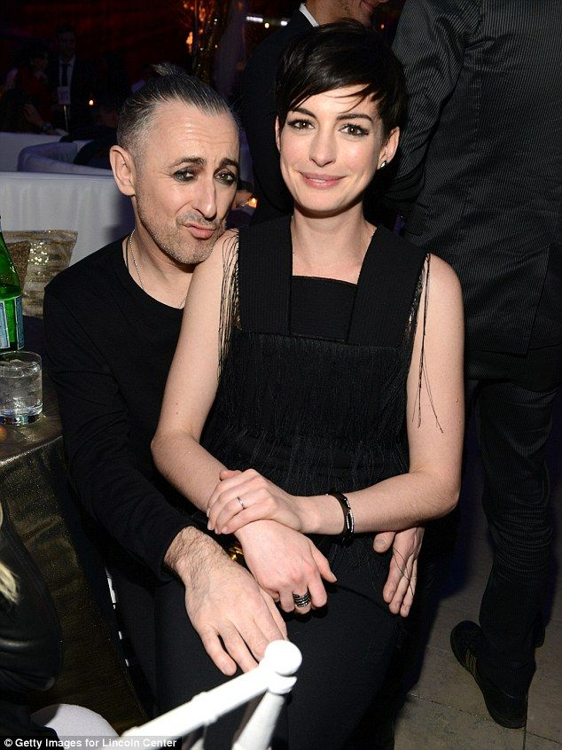 Love him! Buds: Anne also perched on actor Alan Cummings' knee as they pair sat at one of the dinner tables