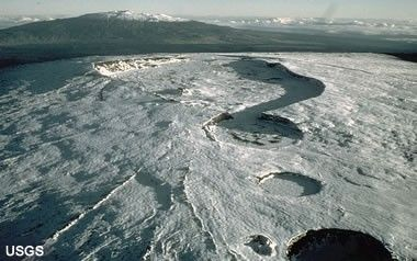 Mauna Loa Volcano: Snow-covered Moku'aweoweo Caldera atop Mauna Loa shield volcano (Mauna Kea in background). The caldera is 3 x 5 km across, 183 m deep, and is estimated to have collapsed between 600-750 years ago.