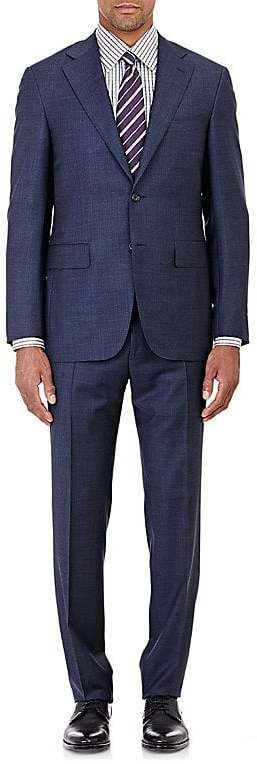 Celebrated for their meticulously tailored silhouettes, Canali suits and sportcoats are made in Italy with a soft construction for a natural look. Canali's blue Capri suit is crafted of Super 130s worsted wool suitable for wearing year-round. Made in Italy, it features a two-button closure, lightly padded shoulders, and a slim fit. Jacket. Slim fit. Two-button closure. Side vents. Notch lapels with boutonnière. Felt-faced collar. Angled welt chest pocket. Flap front pockets.