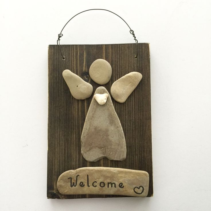 Our Welcome Angel is handmade from beach rocks we find along the shoreline of beautiful Lake Michigan. Even the message is handwritten on a beach rock. We add a wire for easy hanging and a heart shaped rock as a final touch. This angel is perfect for any décor....It welcomes everyone! Wouldnt it look perfect in your foyer...or on a front door...or even in a potted plant on a front porch? It would also make a wonderful and thoughtful gift for someone who just bought a new home or a first…