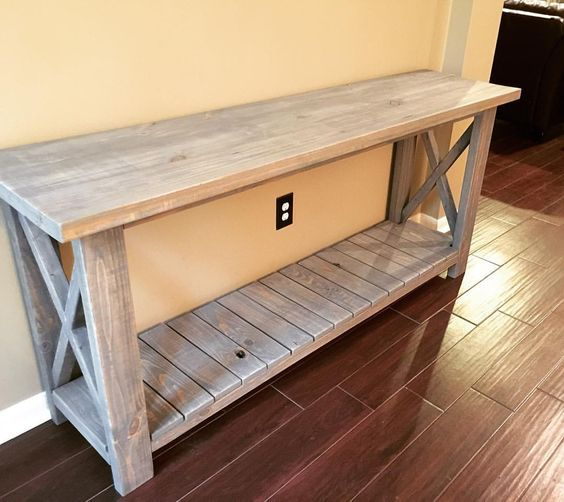 Happy Monday!! I get asked about my console table quite a bit, so I thought I would share for #moveitupmonday hosted by @smalltowngirllife .  My husband combined some plans from @anawhitediy and @shanty2chic to build the table because I liked the planked look at the bottom and only wanted 2 shelves.  We used 1 coat of Minwax Classic Gray and then I sanded it down just a bit! #beautifullybuiltmonday #multigrammonday #minimalisticmonday #makersgonnamakemonday