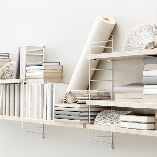 Ash and white String Pocket shelves.