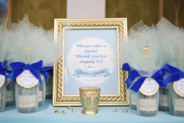 Mini champagne bottle favors, to POP when Mommy pops! A fun idea for guests to have a favor that they use when the baby is born! | Lovelyfest Event Design | Royal Blue Baby Shower