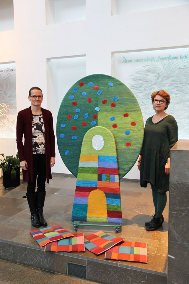 """The tree of Christening"" in Hämeenkylä Church Vantaa 2015. Design Annukka Mikkola (right), weaving Tea Rahkamaa (left). There are seats for the kids on the floor."