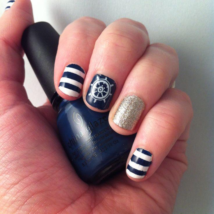 Nail art. Nautical stripes and glitter.