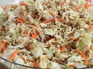 6 oz	bagged cole slaw mix 3 pkg	oriental flavor raman noodles, broken up 1 bunch	green onions, chopped 2/3 c	sunflower seeds 1/2 c	almonds, slivered 3 Tbsp	red wine vinegar 1/2 c	olive oil, extra virgin 1/2 tsp	black pepper 3 Tbsp	sugar 3 pkg	seasoning from the noodles