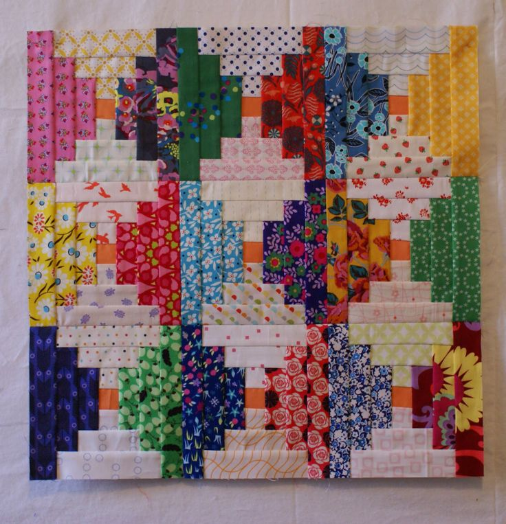Dresden Lane: Courthouse Steps.  With link to a most excellent tutorial and PDF download for paper piecing this block.
