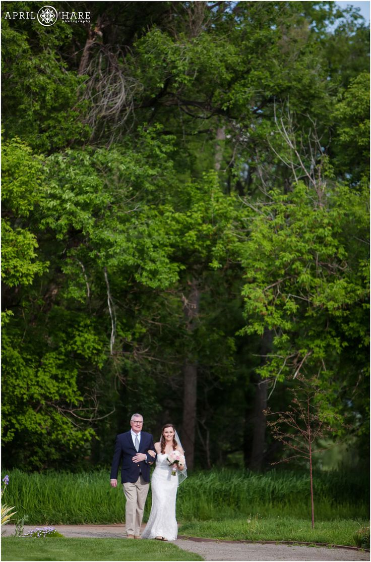 Bride And Her Father Emerge From The Tree Forest At Denver Botanic Gardens  Chatfield Farms On