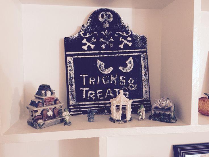 Dollar store Halloween decorations.  Spooky village