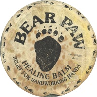 "Bill called this original balm Bear Paw, because he believed that this balm was ""powerful enough to smooth even the roughest bear's paw."" The day before 10,000 Bear Paw tins were to be printed, one of Bill's friends found a tube of Bear Paw hand lotion. While Bill had already checked the trade mark registry for Bear Paw prior to printing the tins, this product had been around for a bit and thus had common law rights to the name."