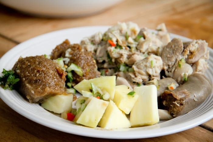 """What it is: The """"pudding"""" in this dish is made with pounded sweet potatoes that are mixed with onions, salt, and pepper. It's then stuffed into a clean pig intestine and tied off — similar to a sausage. It's then cooked in a boiling pot of water. The """"souse"""" is made up of parts of the pig that are pickled – the feet, snout, or ears. It's sometimes served with a picked cucumber on the side.Why you should try it: It's a delicacy that makes sure no food goes to waste.Get a recipe here."""