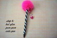 fancy pen with pom pom