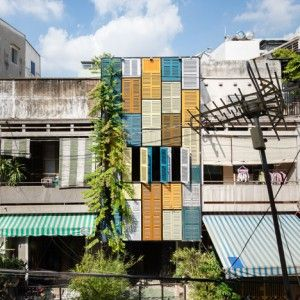 Facade of colourful shutters allows light and wind into Block Architects' Vegan House