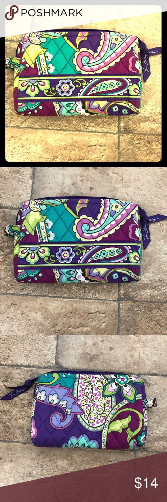 Vera Bradley Small Cosmetic Bag Heather NWOT New without tags small cosmetic bag by Vera Bradley I retired heather pattern. Tags removed but has been stored in my dresser drawer without being used. Hoping to find this beautiful cosmetic bag a home since I have too much Vera Bradley. Vera Bradley Bags Cosmetic Bags & Cases