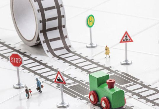 Must have!  Donkey Product's Tape Gallery has railroad themed tape roll that comes with a train and a road themed version that includes a car.  Over 100 feet of track!  Sticks to walls, tables, floors... OMG