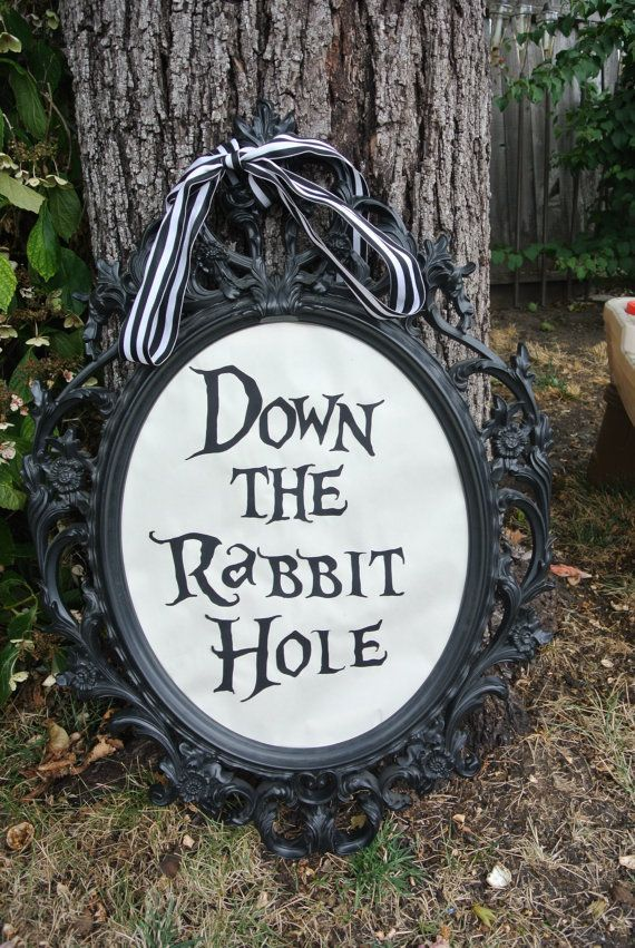 We can make something like this for the sign on the door. Alice in Wonderland Down the Rabbit Hole by AshleySaintGeorge, $5.00