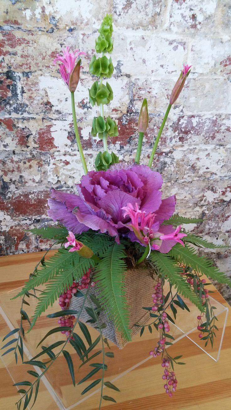 SMALL ORGANIC arrangement featuring kale, nerines, bells of Ireland, peppercorn and umbrella fern.