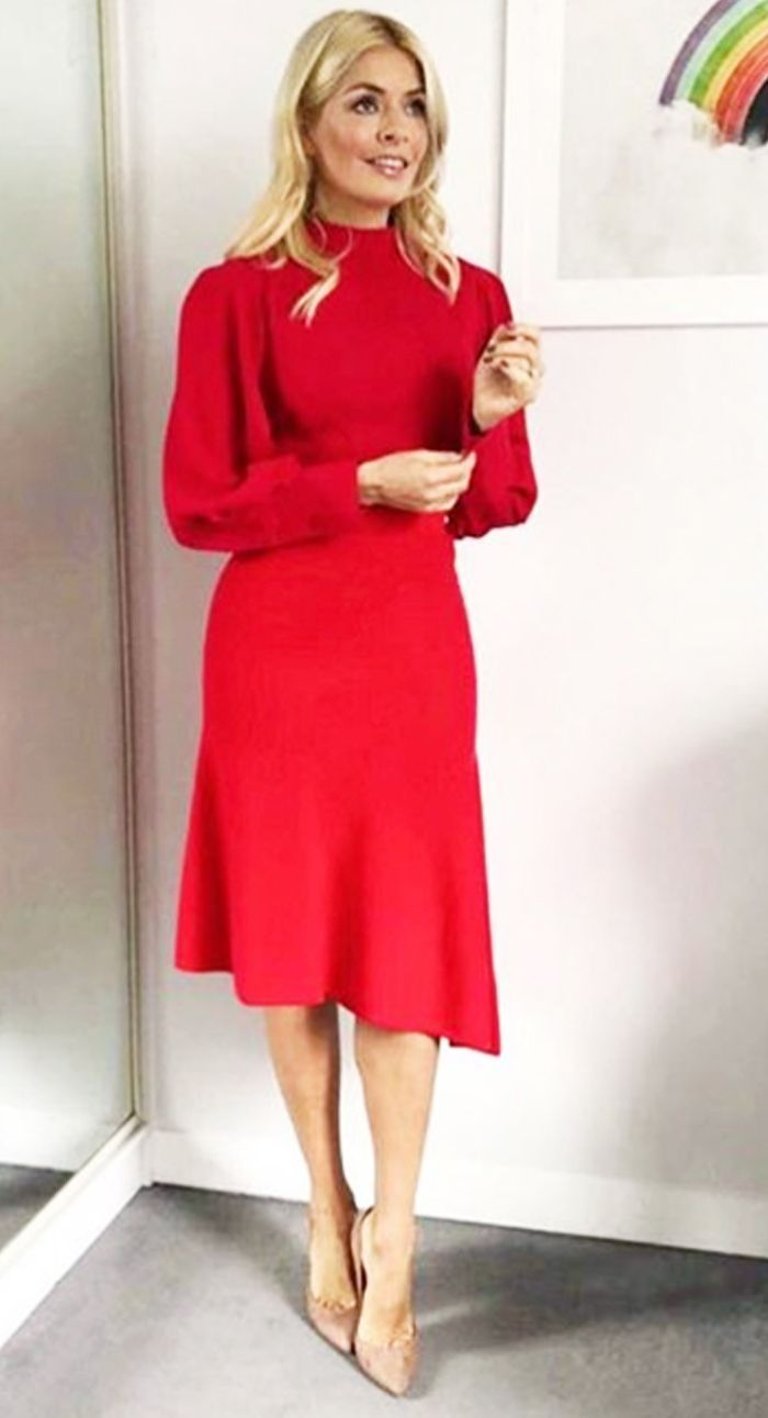 Holly Willoughby has a knack of finding the best high-street pieces, and now she's making us want this red M&S skirt. Click here to see and shop the look.