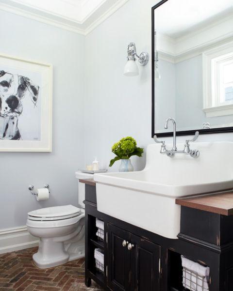 Farmhouse Style Bathroom with Brick Floor