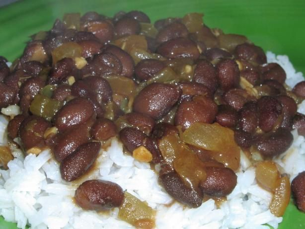 Classic Black Beans and Rice from Food.com:   							This is a typical dish served in Cuba or Puerto Rico, each country has their own method of preparation. You can flavor this dish with meat, but I left it out as I serve it as a side dish with my meats. It is an easy and healthy short cut and takes about 30 minutes to cook.    I used spinach, cilantro and cheese and reduced sodium black beans.