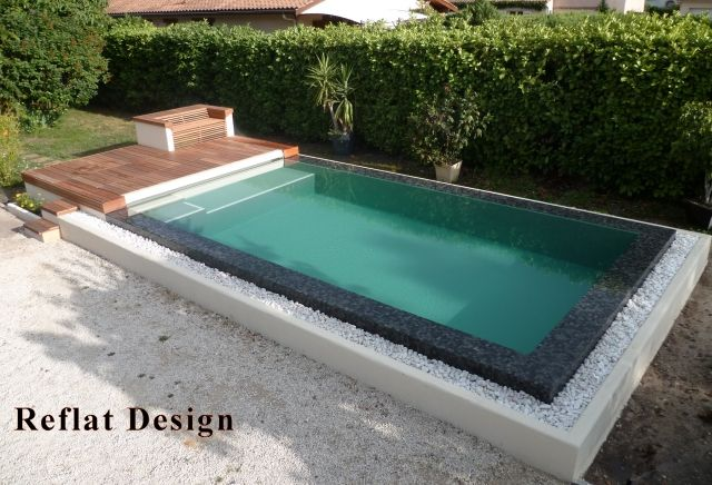 Piscines spas piscine miroir sur lev e niveau variable for Piscine carree miroir