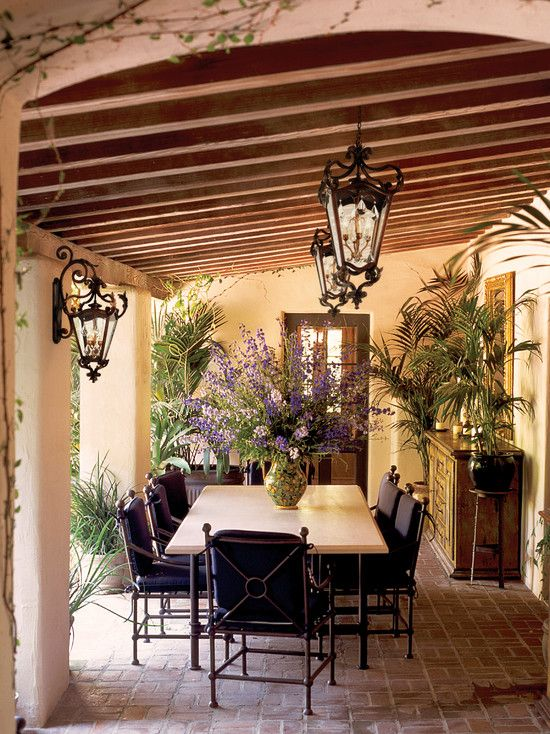 Spanish Colonial Patio-I love this table, big enough to accommodate our large family. and I like the centerpiece