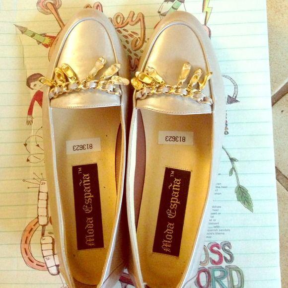 Leather Flat charm beige shoes. Never worn Shoe with gold tone charm decor. Fun wear moda espana Shoes