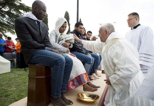 Pope Francis Washes Refugees' Feet In Catholic Ritual