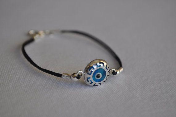 https://www.etsy.com/listing/116753682/glass-evil-eye-silver-bracelet