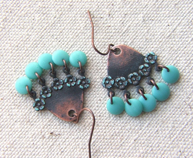 Fab rusty black components accented with Patina Gilder's Paste, and accented with pretty turquoise blue beads....from Joan Williams of Lil Ruby at Etsy: Photo