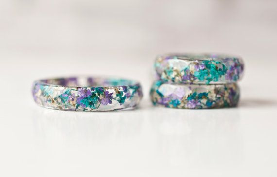 Hey, I found this really awesome Etsy listing at https://www.etsy.com/listing/257744804/stackable-resin-ring-with-tiny-blue-and
