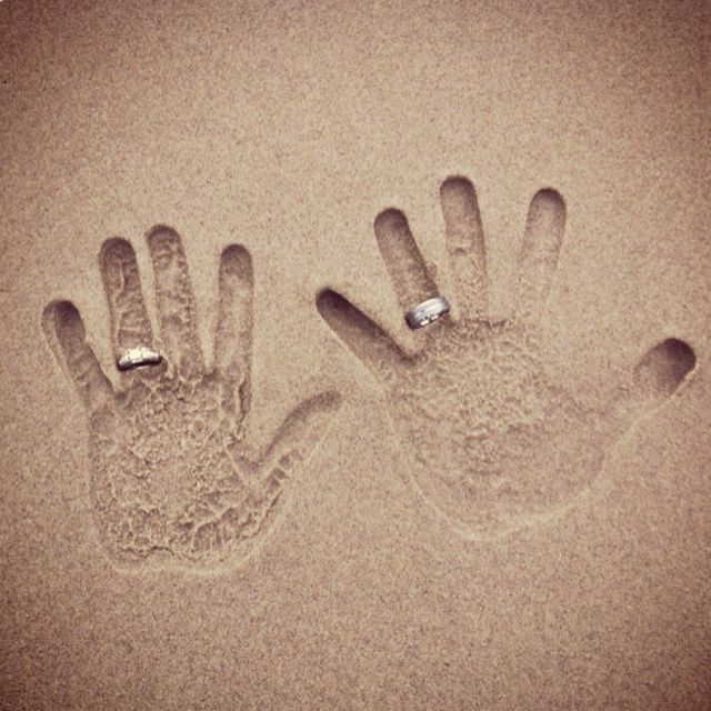 A hands in the sand with wedding bands photo would have been really cute to do on our honeymoon but I didn't see this soon enough. Perhaps our ten year anniversary...