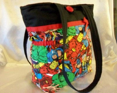 My sis-in-law loves Marvel.  This would be an awesome gift. Marvel Super Hero handmade duffle diaper bag or by designsbykeri4u, $55.99