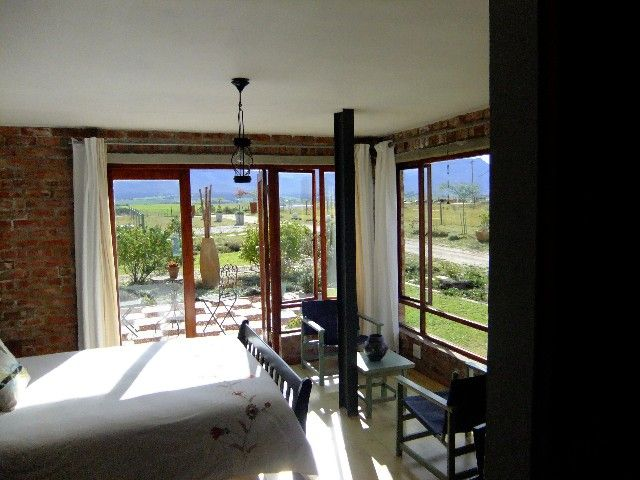 CHANGE YOUR LIFESTYLE - LUXURIOUS LIVING IN THE PEACE OF THE COUNTRYSIDE YET CLOSE TO TOWN. Awesome views from this mountain facing top quality home on a six hectare property with three dams. Extra spacious with large living areas. Main bedroom with exit to outside has double showers and a large dressing room en-suite. Three bedrooms and a study upstairs and three bedrooms and a study downstairs. Johan van Eeden 082 827 1138 Johan.veeden@seeff.com