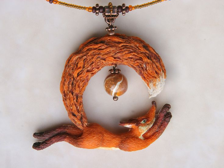 So cute!! Polymer clay fox chasing it's tail necklace!