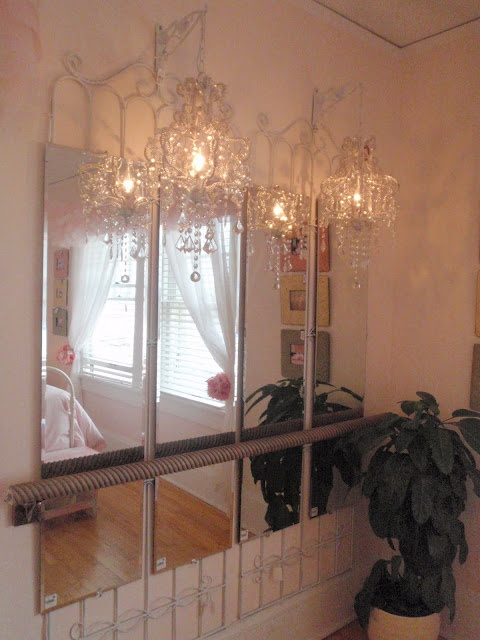 They put a garden trellis behind the 4 mirrors and used a decorative hand rail and made a ballet bar. Isn't it so cute with the chandeliers?