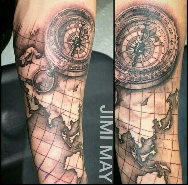 Compass on world map wrapping around the forearm tattoos