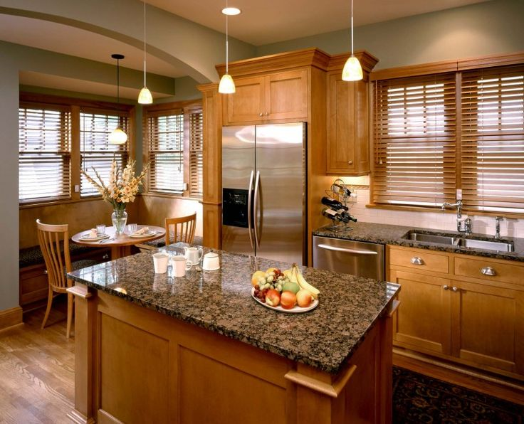 wood island wood cabinet brown granite countertop stainless steel appliances pendant lights of Installing Ice Brown Granite Countertop for Your Home Design