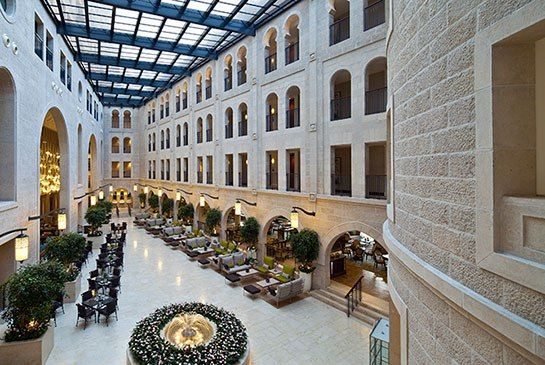 Waldorf Astoria Opens a Stunning New Hotel in Jerusalem I A retractable roof covers the hotel's soaring atrium.