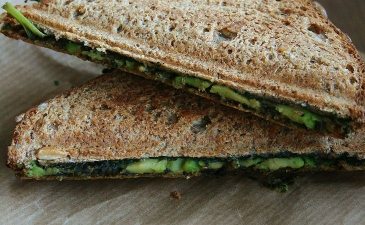 Vegan grilled sandwich with pesto, spinach, avocado and nutritional yeast